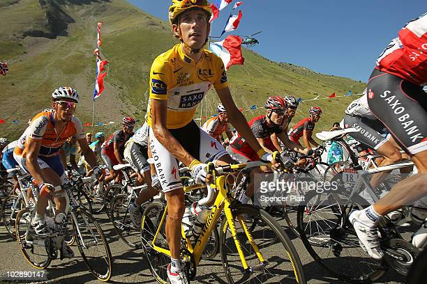 Andy Schleck of team Saxo Bank wears the yellow jersey while riding the 179km Stage 10 of the Tour de France on July 14 2010 in Gap France The route...