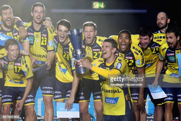Andy Schmid of RheinNeckar Loewen and his tzeam mates celebrate winning the Pixum DHB Handball Super Cup 2017 between RheinNeckar Loewen and THW Kiel...