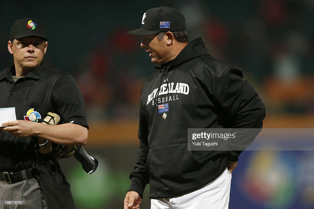 Andy Skeels manager of Team New Zealand talks with home plate umpire D.J. Reyburn #70 during Game 6 of the 2013 World Baseball Classic Qualifier against Team Chinese Taipei at Xinzhuang Stadium in New Taipei City, Taiwan on Sunday, November 18, 2012.