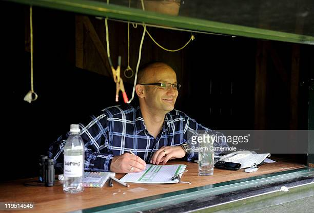 Andy Smith keeps score during an exclusive cricket day match in the idyllic surroundings of the Getty family estate at Wormsley Buckinghamshire on...
