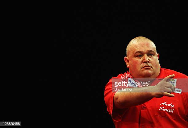 Andy Smith of England reacts during his game against Gary Anderson of Scotland during day 12 in the 2011 Ladbrokescom World Darts Championship at...
