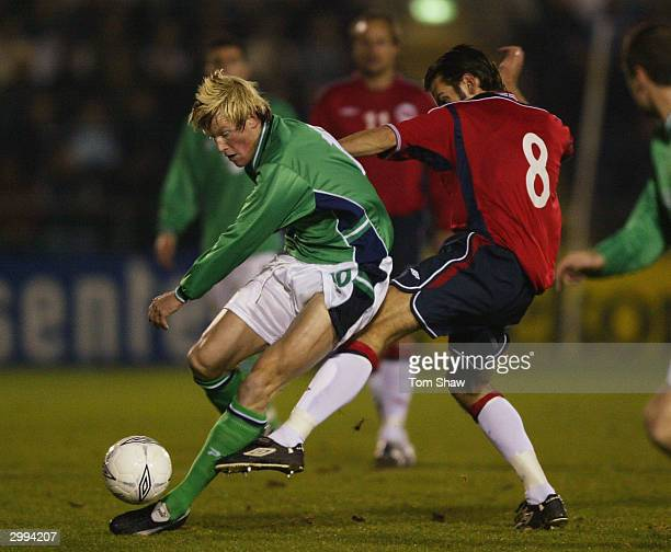 Andy Smith of Northern Ireland tussles with Magne Hoset of Norway during the International Friendly match between Northern Ireland and Norway at...