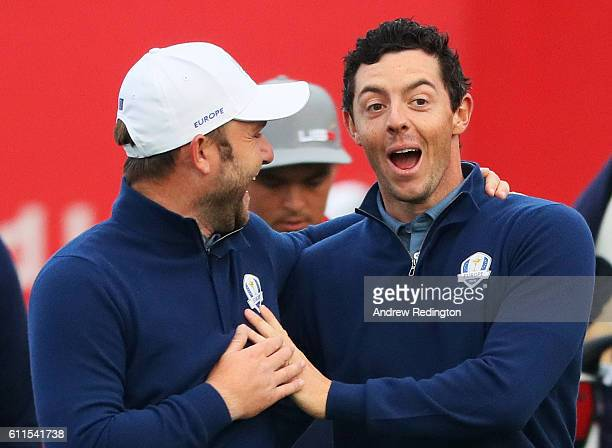Andy Sullivan and Rory McIlroy of Europe walk off the first tee during morning foursome matches of the 2016 Ryder Cup at Hazeltine National Golf Club...