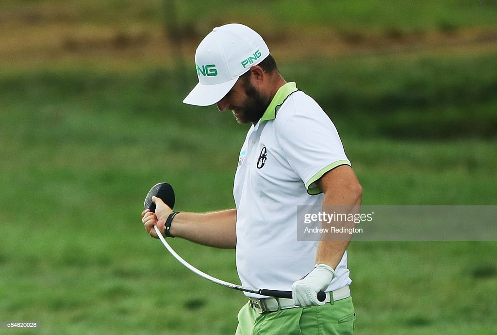 Andy Sullivan of England bends his club on the 18th hole during the continuation of the weather delayed third round of the 2016 PGA Championship at Baltusrol Golf Club on July 31, 2016 in Springfield, New Jersey.