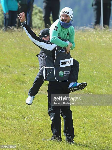 Andy Sullivan of England celebrates an albatross on the 1st hole with his caddie during the Second Round of the Dubai Duty Free Irish Open Hosted by...