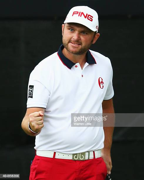 Andy Sullivan of England celebrates his final putt on the 18th green during the Joburg Open final round at Royal Johannesburg and Kensington Golf...