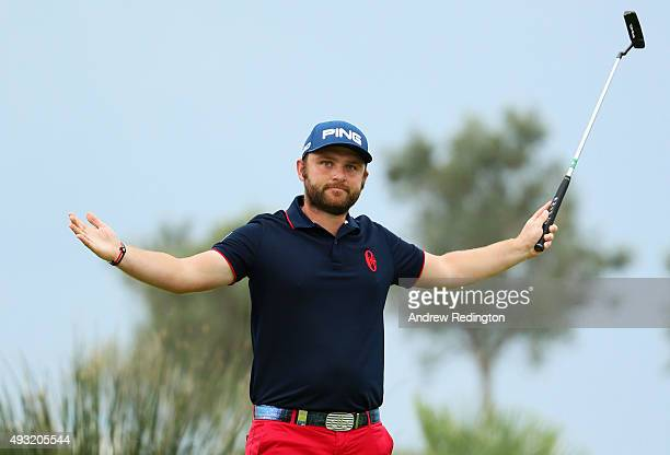 Andy Sullivan of England celebrates victory on the 18th green during the Portugal Masters final round at Oceanico Victoria Golf Club on October 18...
