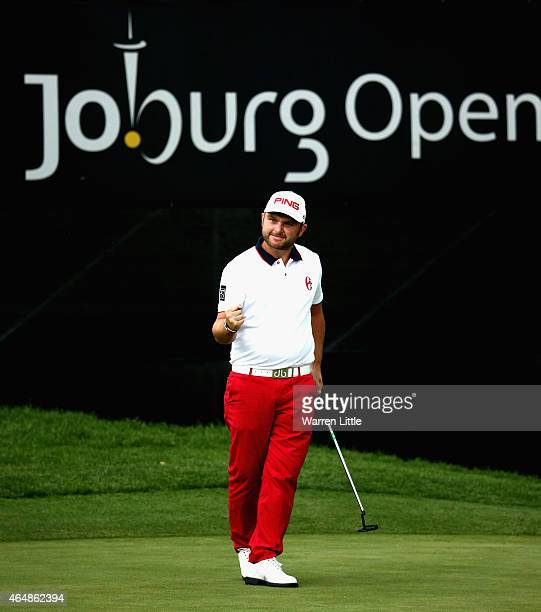Andy Sullivan of England celebrates winning the Joburg Open at Royal Johannesburg and Kensington Golf Club on a score of 17 under par on March 1 2015...