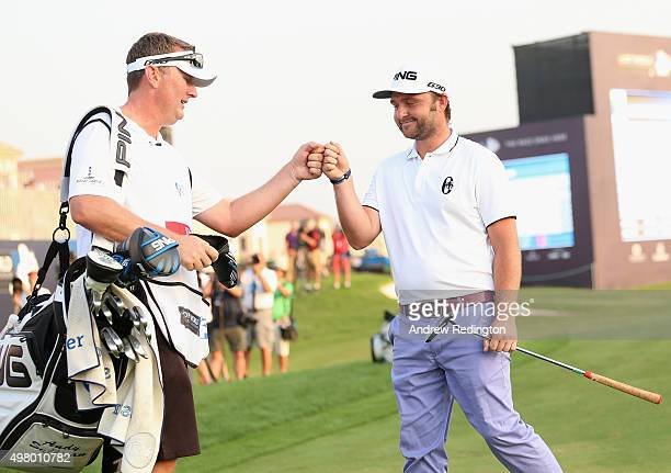 Andy Sullivan of England celebrates with his caddie Sean Mcdonagh after his birdie on the 18th hole during the second round of the DP World Tour...