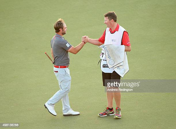 Andy Sullivan of England celebrates with his caddie Sean Mcdonagh after his par on the 18th holeduring the third round of the DP World Tour...