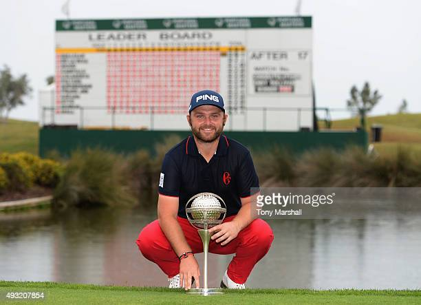 Andy Sullivan of England celebrates with the trophy after winning the Portugal Masters at Oceanico Victoria Golf Club on October 18 2015 in Albufeira...