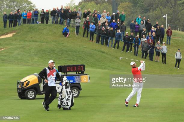 Andy Sullivan of England hits his second shot on the 4th hole on the shot clock during the Group A match between England and India during day one of...