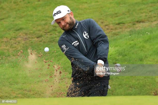 Andy Sullivan of England hits his third shot on the 18th hole which he holed for an eagle during day three of the AAM Scottish Open at Dundonald...