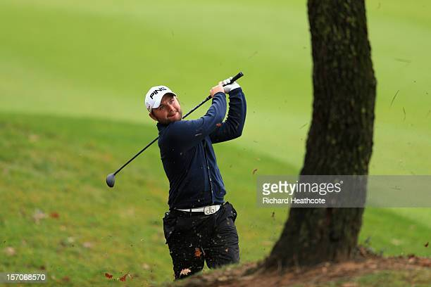 Andy Sullivan of England plays from around a tree on the 15th during the fifth round of the European Tour Qualifying School Finals at PGA Catalunya...