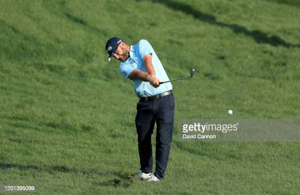 Andy Sullivan of England plays his second shot on the 10th hole during the first round of the Omega Dubai Desert Classic on the Majlis Course at The...
