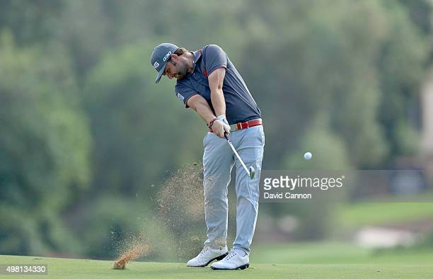 Andy Sullivan of England plays his second shot on the par 4 third hole during the third round of the 2015 DP World Tour Championship on the Earth...