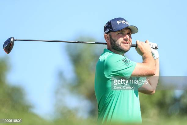 Andy Sullivan of England plays his tee shot on the third hole during the final round of the Abu Dhabi HSBC Championship at Abu Dhabi Golf Club on...