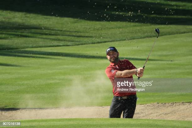 Andy Sullivan of England plays his third shot from a bunker on the second hole during round two of the Abu Dhabi HSBC Golf Championship at Abu Dhabi...