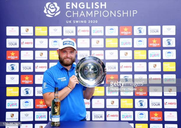 Andy Sullivan of England poses for a photo with the trophy after winning the English Championship at Hanbury Manor Marriott Hotel & Country Club on...