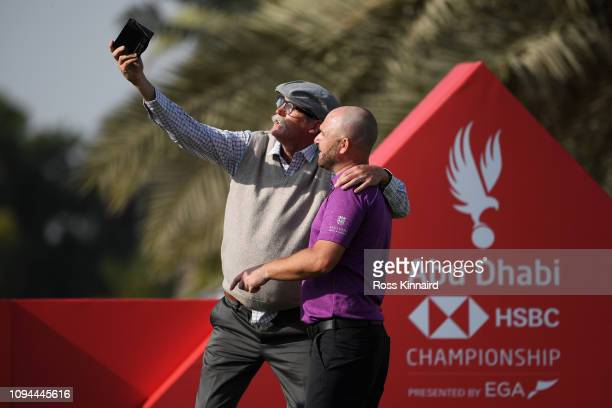 Andy Sullivan of England poses for a selfie with trick shot performer Kevin Carpenter during the ProAm ahead of the Abu Dhabi HSBC Golf Championship...