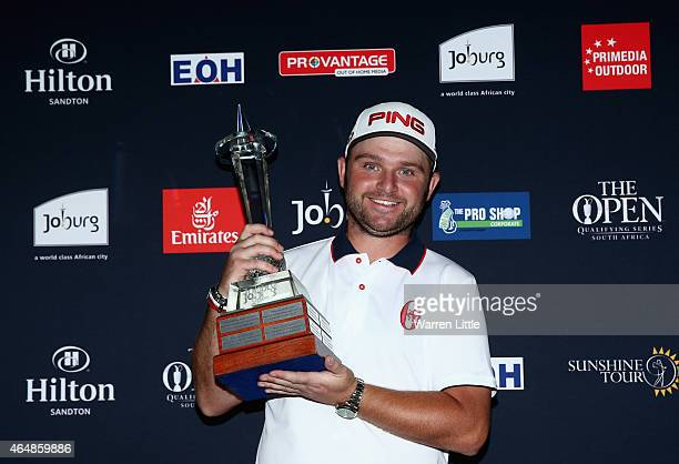 Andy Sullivan of England poses with the trophy after winning the Joburg Open at Royal Johannesburg and Kensington Golf Club on a score of 17 under...