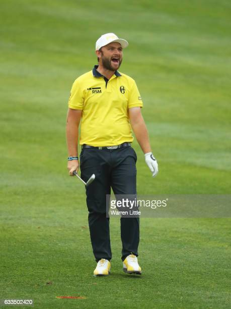 Andy Sullivan of England reacts after he plays his second shot on the 12th hole during the first round of the Omega Dubai Desert Classic at Emirates...