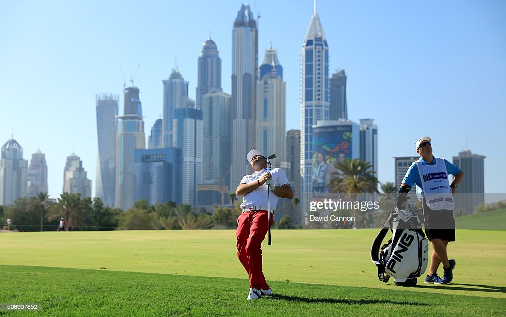 Andy Sullivan of England reacts to his second shot at the par 5, 13th hole during the final round of the 2016 Omega Dubai Desert Classic on the Majlis Course at the Emirates Golf Club on February 7, 2016 in Dubai, United Arab Emirates.