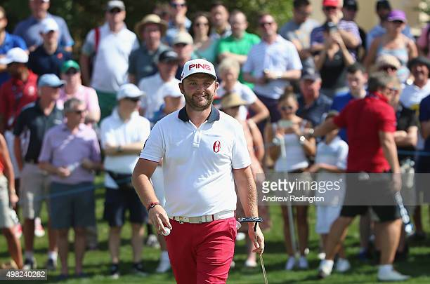 Andy Sullivan of England smiles after his birdie on the second hole during the final round of the DP World Tour Championship on the Earth Course at...