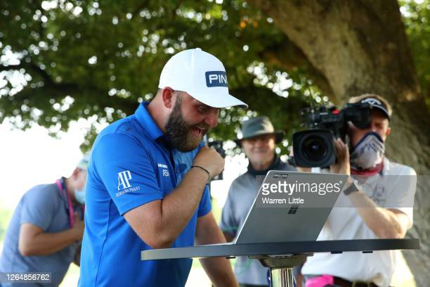 Andy Sullivan of England speaks to his family via video after winning the English Championship during day four of the English Championship at Hanbury...