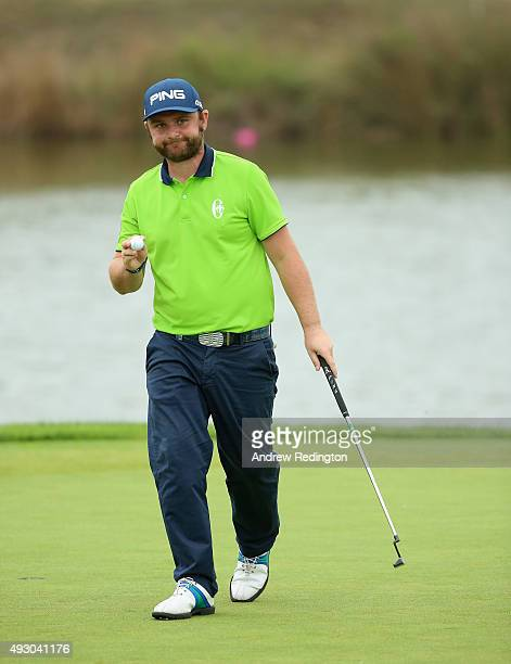 Andy Sullivan of England waves to the crowd after his birdie on the 17th hole during the third round of the Portugal Masters at Oceanico Victoria...