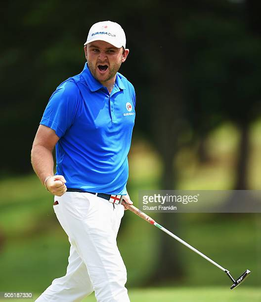 Andy Sullivan of team Europe celebrates a putt during thee second day's foursome matches at the EurAsia Cup presented by DRBHICOM at Glenmarie GCC on...