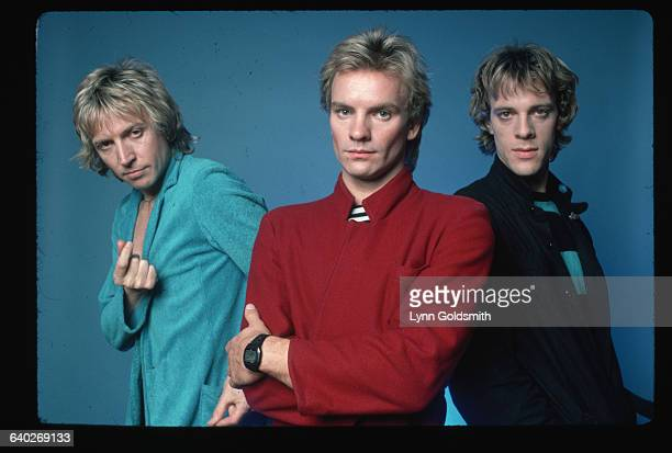 Andy Summers in a blue blazer Sting in a red jacket and Stewart Copeland in a striped shirt