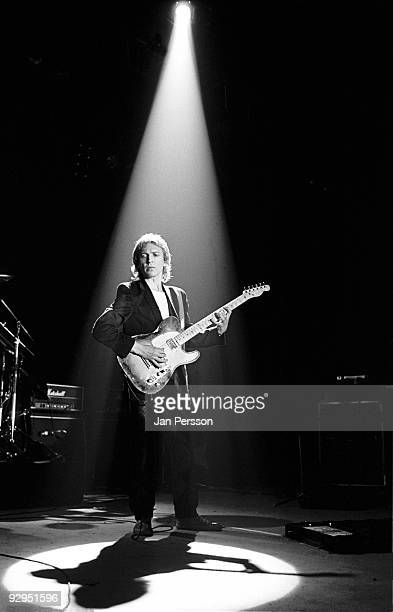 Andy Summers of The Police performs on stage in a spotlight at the Brondbyhallen on January 5th 1982 in Copenhagen Denmark He plays a Fender...