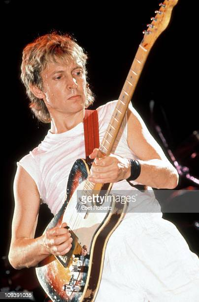 Andy Summers performs on stage with The Police in St Louis Missouri on June 24 1983 He plays a Fender Telecaster guitar
