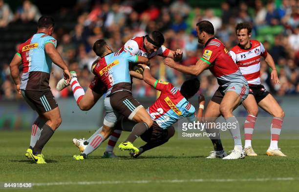Andy Symons of Gloucester Rugby is tackled during the Aviva Premiership match between Harlequins and Gloucester Rugby at Twickenham Stoop on...