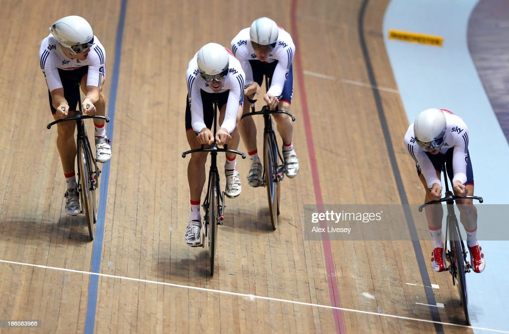 Andy Tennant, Owain Doull, Ed Clancy and Steven Burke of Great Britain cross the line to win gold in the Men's Team Pursuit Final on day one of the UCI Track Cycling World Cup at Manchester Velodrome on November 1, 2013 in Manchester, England.