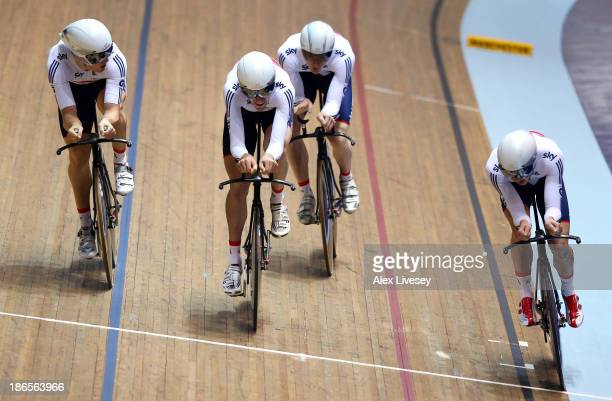 Andy Tennant Owain Doull Ed Clancy and Steven Burke of Great Britain cross the line to win gold in the Men's Team Pursuit Final on day one of the UCI...