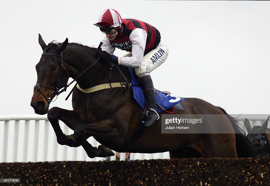 Andy Thornton and Even More clear an early fence before landing The coralpoker.com Handicap Chase Race run at Wincanton Racecourse on February 10, 2005 in Wincanton, England.