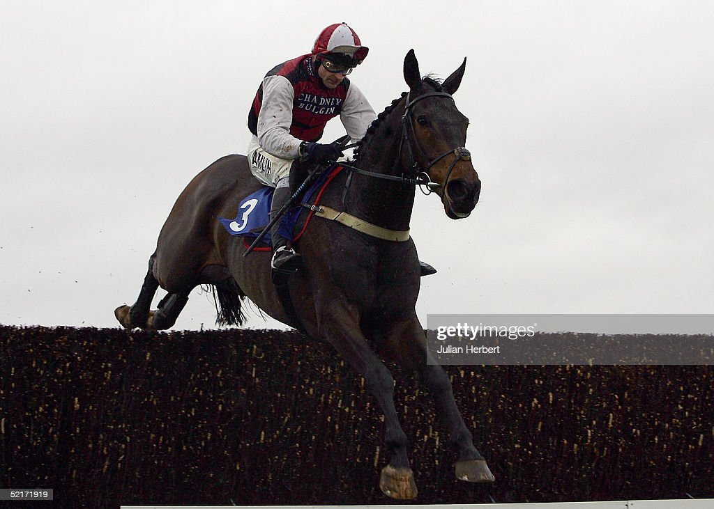 Andy Thornton and Even More clear the second last fence before landing The coralpoker.com Handicap Chase Race run at Wincanton Racecourse on February 10, 2005 in Wincanton, England.