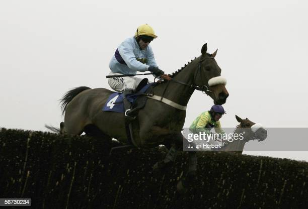 Andy Thornton and See You Sometime lead the Christian Williams ridden Royal Auclaiar over the second last fence before landing The HBLB Cotswold...