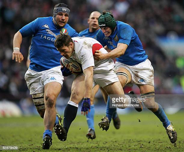 Andy Titterrell of England is dragged back by Silvio Orlando of Italy during the RBS Six Nations International between England and Italy at...