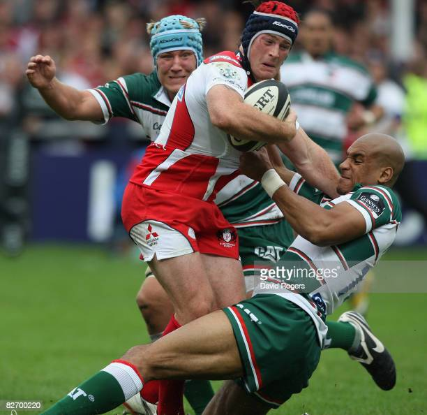 Andy Titterrell of Gloucester is tackled by Jordan Crane and Tom Varndell during the Guinness Premiership match between Gloucester and Leicester...