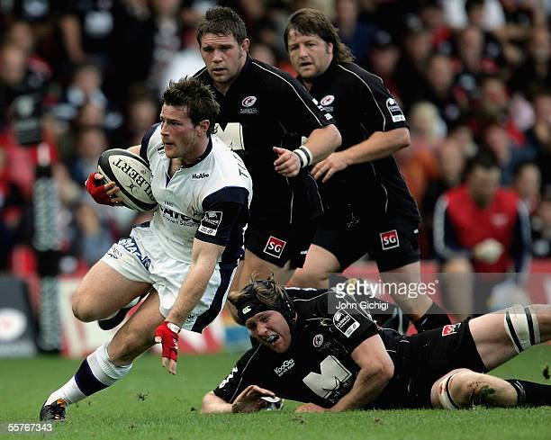 Andy Titterrell of Sale evades the Saracens defence during the Guiness Premiership match between Saracens and Sale Sharks at Vicarage Road on...