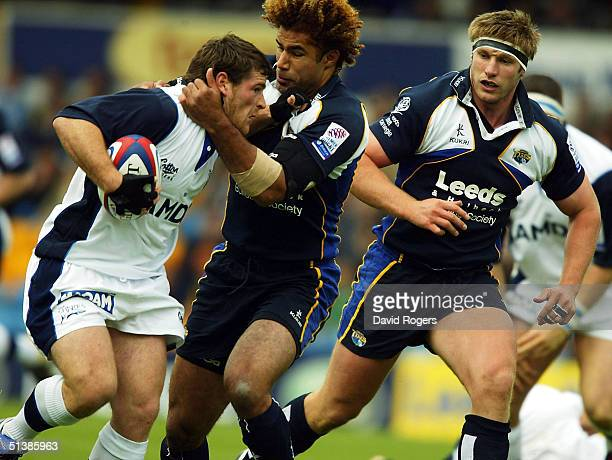Andy Titterrell of Sale is tackled by Richard Parks during the Zurich Premiership match between Leeds Tykes and Sale Sharks at Headingley on October...