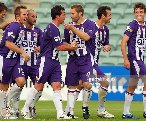 Andy Todd of the Glory congratulates Robbie Fowler after scoring his second goal during the round 14 ALeague match between the Perth Glory and the...