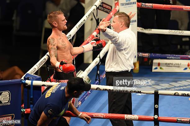 Andy Townend of Great Britain gestures to the referee after he stops the fight in favour of Martin Joseph Ward of Great Britain during the vacant...