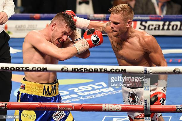 Andy Townend of Great Britain throws a right hand punch on Martin Joseph Ward of Great Britain during the vacant Super Featherweight title fight at...
