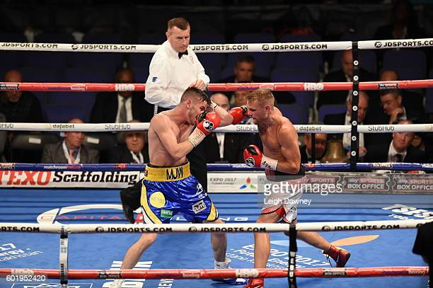 Andy Townend of Great Britain trades punches with Martin Joseph Ward of Great Britain during the vacant Super Featherweight title fight at The O2...