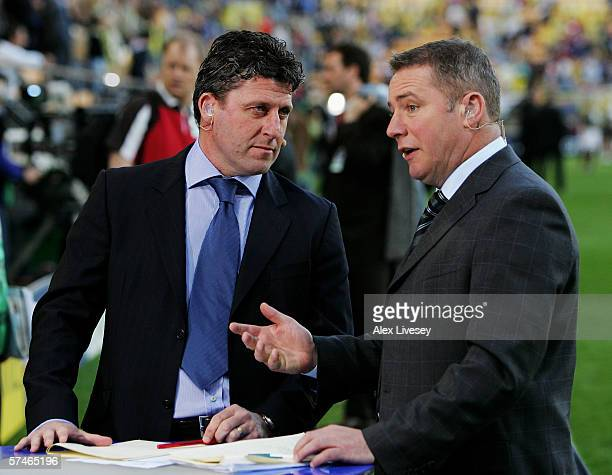 Andy Townsend and Ally McCoist speak pitchside prior to the Champions League Semi Final Second Leg match between Villarreal and Arsenal at the El...