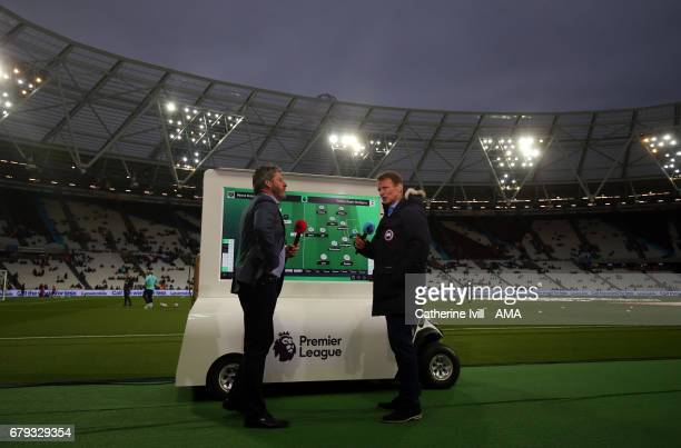 Andy Townsend and Teddy Sheringham report pitchside before the Premier League match between West Ham United and Tottenham Hotspur at London Stadium...